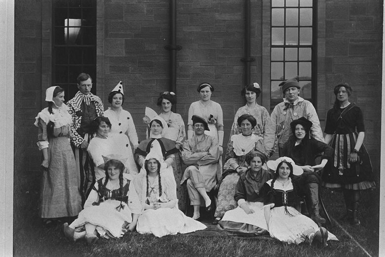 A black and white archive photo of hospital staff dressed up in novelty outfits ahead of a pageant