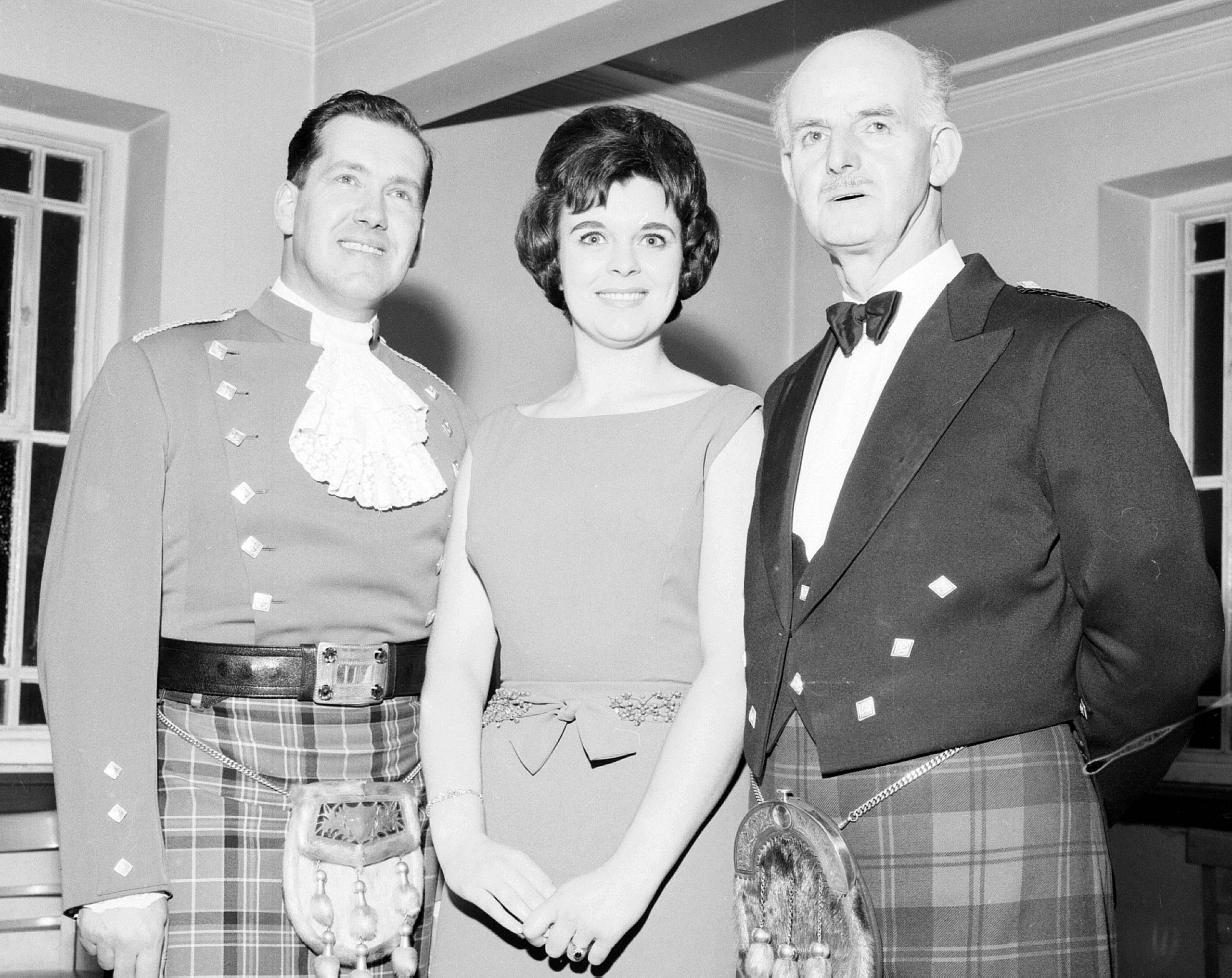 three people posing in formal wear