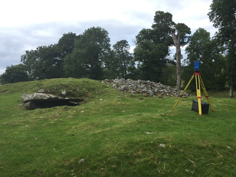 Laser scanning equipment on a tripod outside a burial cairn
