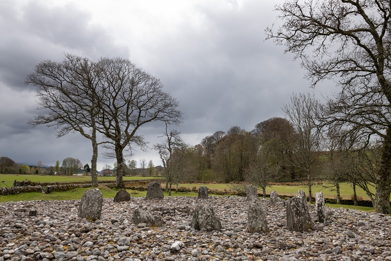 View of a stone circle comprising 13 standing stones.