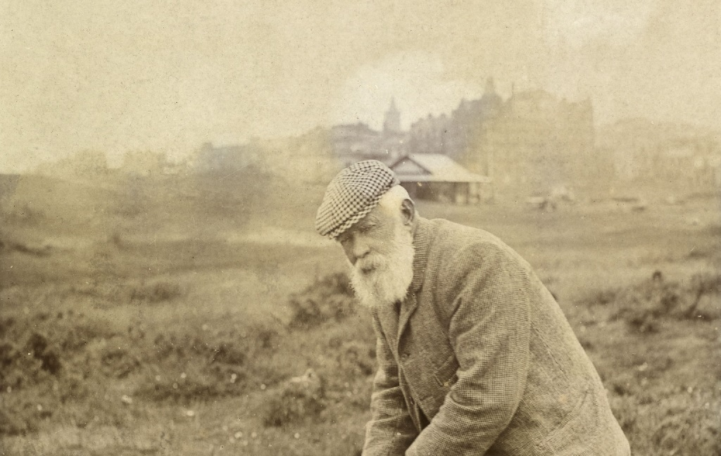 Cutaway of an archive photo of Old Tom Morris taking a golf shot