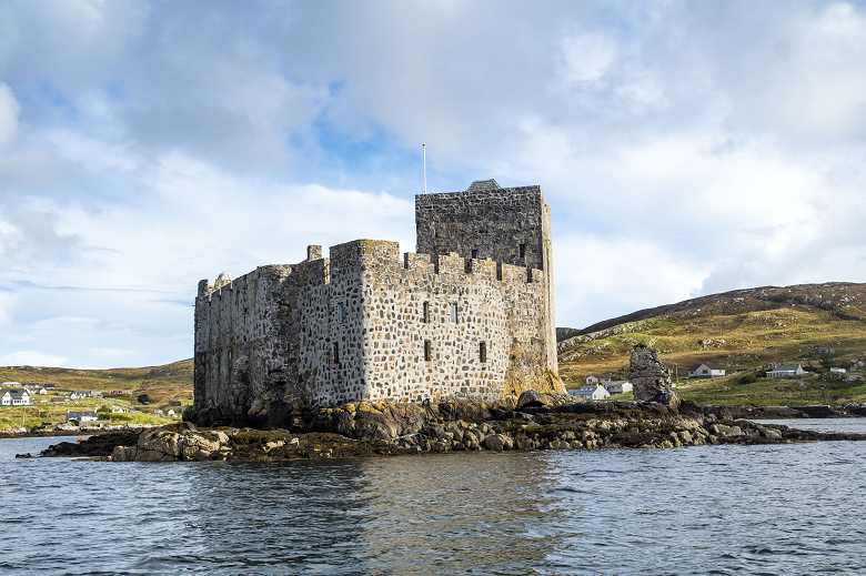 A formidable stone castle built on a small island in a bay