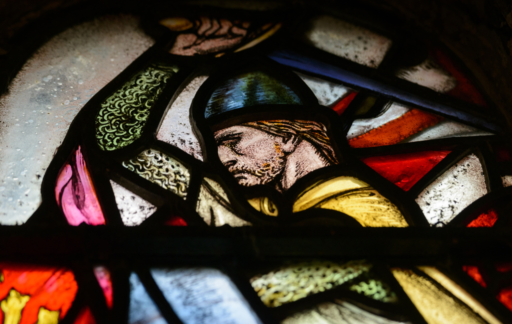 stained glass showing man with sword