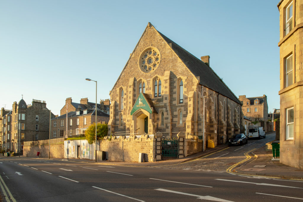 A historic church building repurposed into the Tayside Islamic Cultural Education Centre with an elaborate new porch and railings