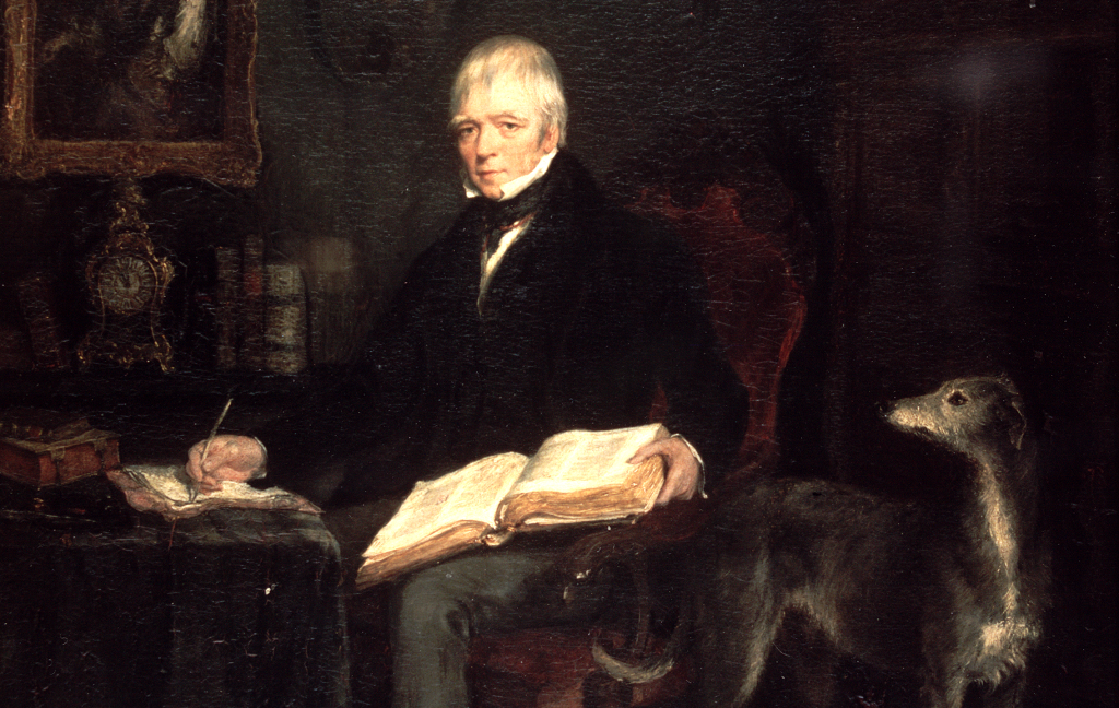 A portrait of Walter Scott in his later years at work in his library. A large open book is resting on his lap and a greyhound stands at his side.