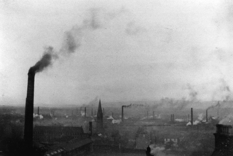 skyline with Victorian factories belching out smoke