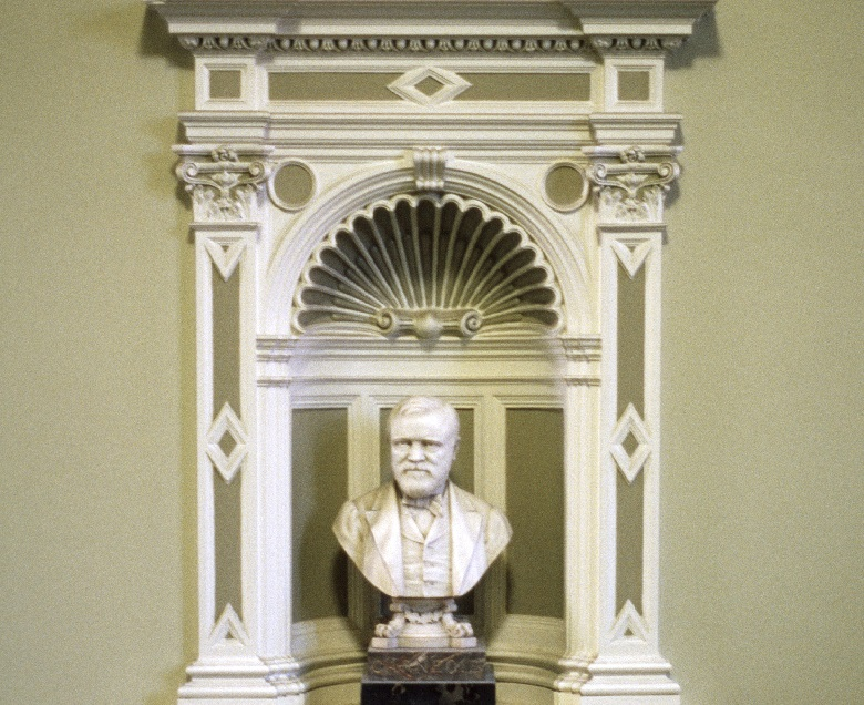 A bust of Andrew Carnegie set into an alcove of a public building