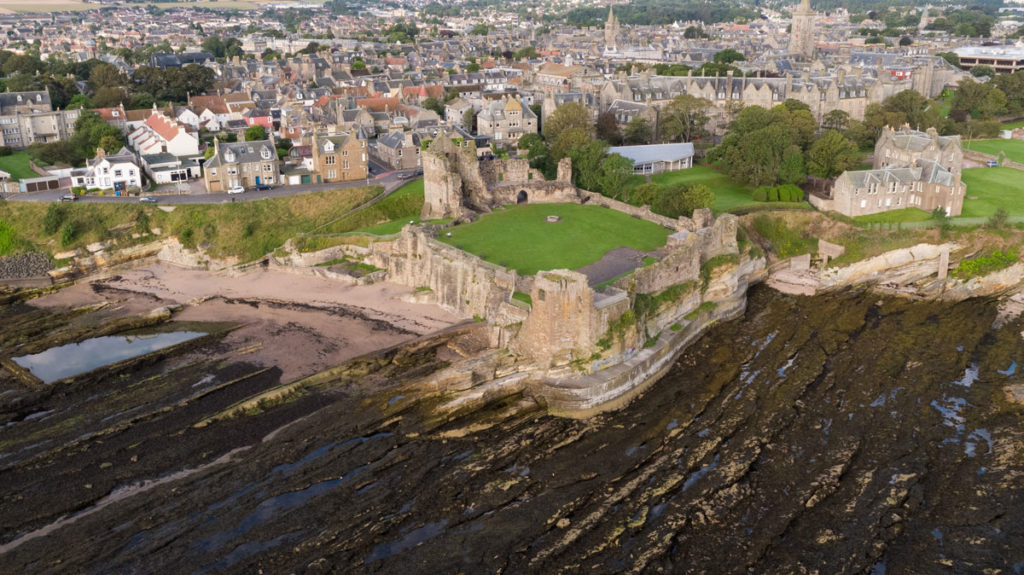 A view over St Andrews Castle while the tide is out, looking towards the town of St Andrews