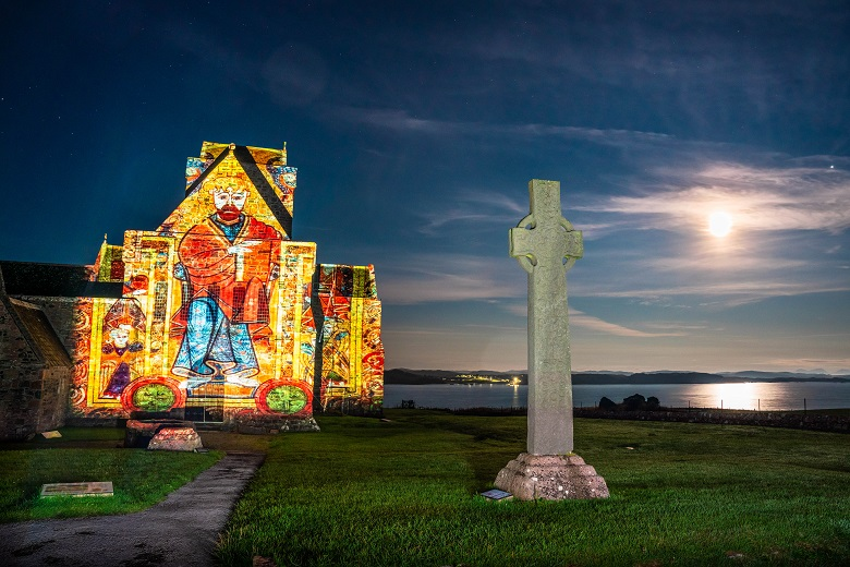 A colourful projection inspired by the pages of the Book of Kells is projected onto an abbey wall